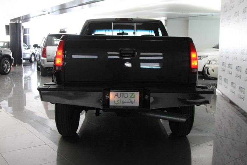 Black Chevrolet Silverado V8 1994 from the back