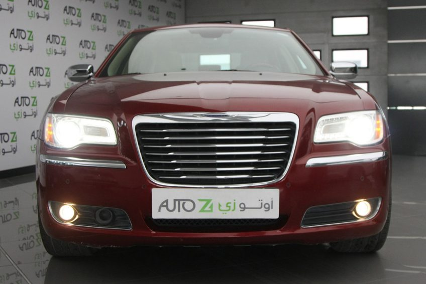 Red Chrysler 300C V8 at autoz qatar
