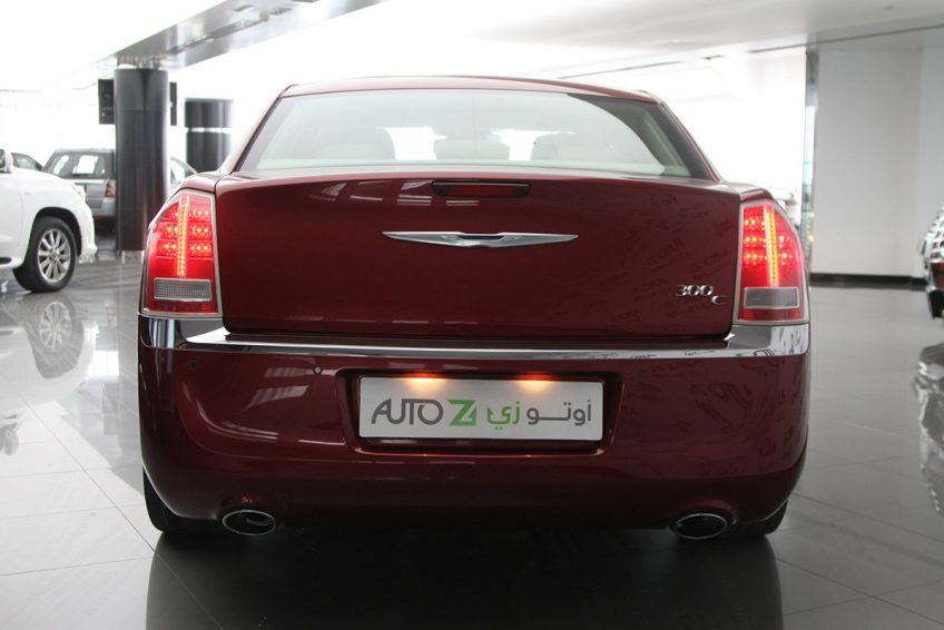 Red Chrysler 300C V8 from the back at autoz qatar