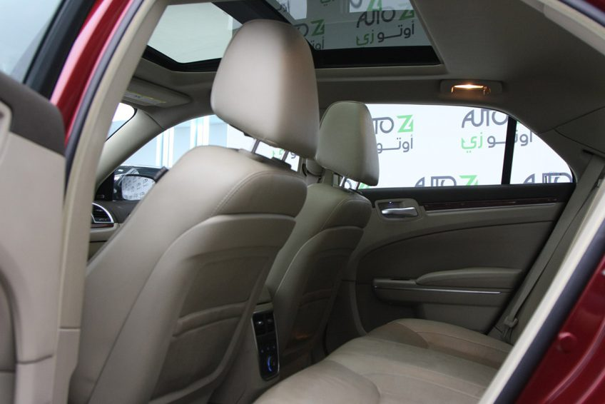 Red Chrysler 300C V8 interior at autoz Qatar