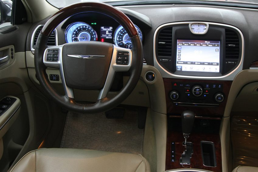 Red Chrysler 300C V8 dashboard at autoz Qatar