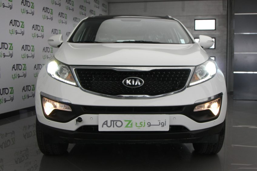 صورة أمامية لسيارة كيا سبورتاج بيضاء جديدة من اوتو زي قطر