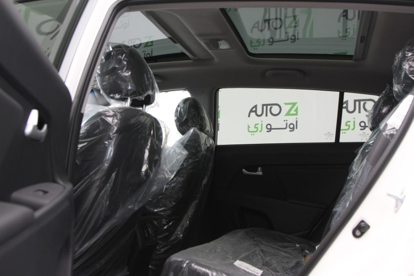 المقاعد الخلفية لسيارة كيا سبورتاج بيضاء جديدة من اوتو زي قطر