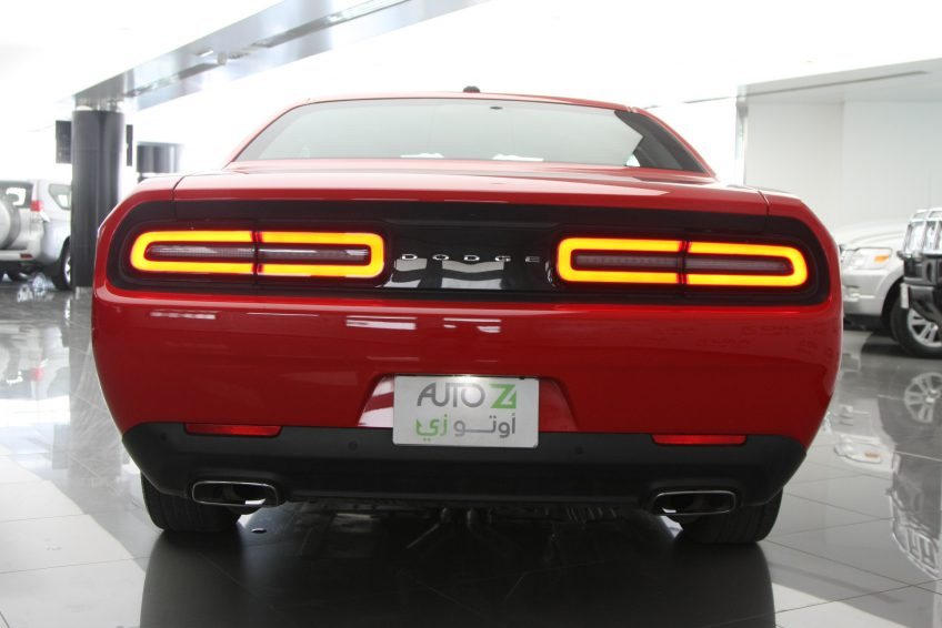 Red Dodge Challenger V6 from the back