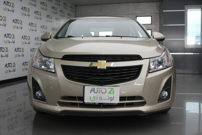 Chevrolet Cruze LT 2013 from outside at autoz car showroom in qatar