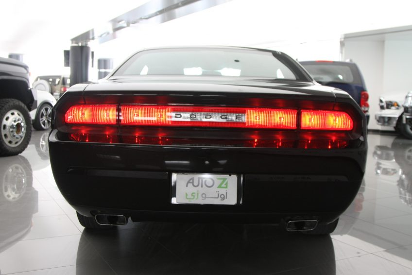 Black Dodge Challenger V6 from the back at autoz Qatar