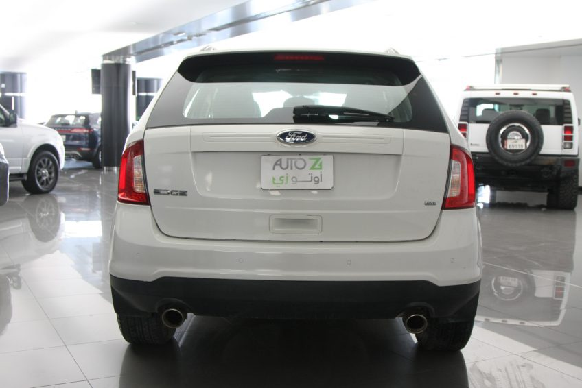 Used White Ford Edge from the back