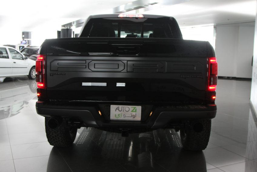 Black Ford Raptor V8 from the back