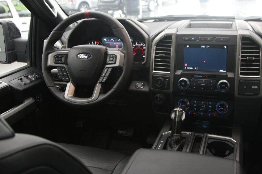 Black Ford Raptor V8 dashboard