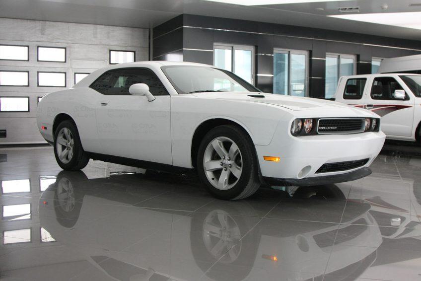 White Dodge Challenger V6 at autoz Qatar